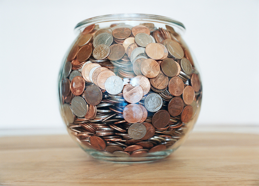 A fishbowl full of coins.