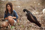 14 year old Isabel Durham observes a great frigatebird (Fregata minor) from the trail on Genovesa Island, Galapagos Archipelago - Ecuador. (fully released - 82010EXsP)