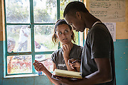 ? and George Dennis  planning as the team of volunteers prepare for their school training session with pupils as part of the ICS Raleigh SWASH (school water, sanitation and hygiene plan) project. Mbulu, Manyara district, Tanzania. Working in partnership with the Diocese of Mbulu Development Department (DMDD); part of Caritas Tanzania.