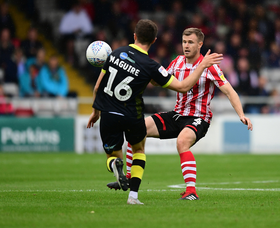 Lincoln City's Michael O'Connor vies for possession with Crawley Town's Joe Maguire<br /> <br /> Photographer Chris Vaughan/CameraSport<br /> <br /> The EFL Sky Bet League Two - Lincoln City v Crawley Town - Saturday September 8th 2018 - Sincil Bank - Lincoln<br /> <br /> World Copyright © 2018 CameraSport. All rights reserved. 43 Linden Ave. Countesthorpe. Leicester. England. LE8 5PG - Tel: +44 (0) 116 277 4147 - admin@camerasport.com - www.camerasport.com