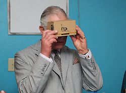 The Prince of Wales uses a Google cardboard viewer to look at pictures of Virgin Gorda, during a visit to the Youth Empowerment Project in The British Virgin Islands, where he was given a guided tour of the centre and viewed damage caused by the storm and demonstrations from children of the activities provided by the project, as he continues his tour of hurricane-ravaged Caribbean islands.