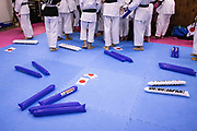 """Stick balloons are seen on the floor before watching Japan's Ryo Kiyuna performs in the men's kata final bout of the karate competition during the Tokyo 2020 Olympic Games on TV at a """"dojo"""" of Kenkojuku Budokan karate school in Hachioji area of Tokyo on August 6, 2021. (Photo by Yuki IWAMURA / AFP)"""