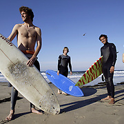 Surfers with their surfboards in Santa Barbara, CA. Model Released