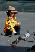 Child (6 years old) feeding the pigeons. Sydney, Australia