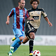 Trabzonspor's Serkan BALCI (L) and Benfica's Axel WITSEL (R) during their UEFA Champions League third qualifying round, second leg, soccer match Trabzonspor between Benfica at the Ataturk Olimpiyat Stadium at İstanbul Turkey on Wednesday, 03 August 2011. Photo by TURKPIX