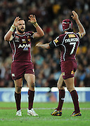 May 25th 2011: Jonathan Thurston high fives Nate Myles of the Maroons during game 1 of the 2011 State of Origin series at Suncorp Stadium in Brisbane, Australia on May 25, 2011. Photo by Matt Roberts/mattrIMAGES.com.au / QRL