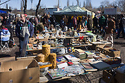 Bric-a-brac and old possessions being sold at a giant market in Mauerpark - an open space on the site of the old Berlin wall, the former border between Communist East and West Berlin during the Cold War.