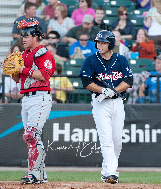 New Hampshire Fisher Cats catcher Travis D'Arnaud approaches the plate during Saturday's game with the Portland Sea Dogs.  (Karen Bobotas/for the Concord Monitor)