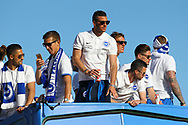 Brighton & Hove Albion centre forward Tomer Hemed on the open top bus during the Brighton & Hove Albion Football Club Promotion Parade at Brighton Seafront, Brighton, East Sussex. United Kingdom on 14 May 2017. Photo by Ellie Hoad.
