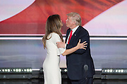 GOP Presidential candidate Donald Trump kisses his wife Melania after accepting the party nomination for president on the final day of the Republican National Convention July 21, 2016 in Cleveland, Ohio.