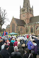 "© Licensed to London News Pictures. 3/4/2015. Solihull, West Midlands, UK. The Good Friday ""Walk of Witness"" taking place in Solihull. People of all faiths congrgate outside St Alphege Church and walk the short distance to Mell Square to hold a multi-faith prayer meeting. Pictured, crowds praying before taking part in the ""Walk of Witness"". Photo credit : Dave Warren/LNP"