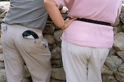 Woman with a hip sack and a man with his back pockets full