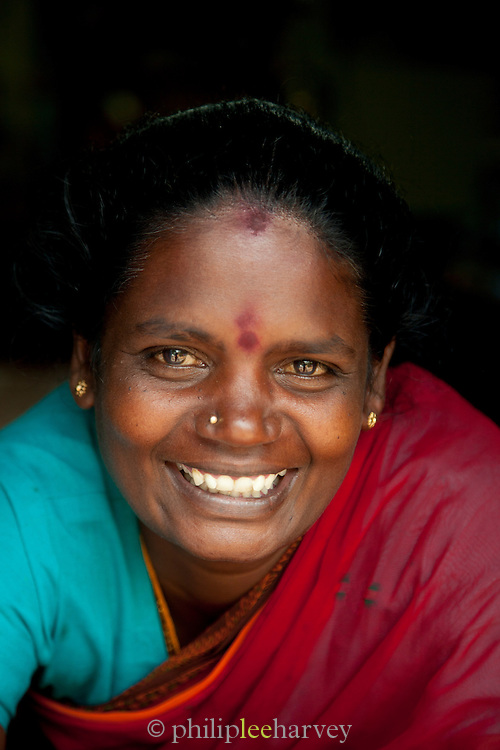 Tea picker in her home near the plantation in Munnar, a hill station in Kerala, India