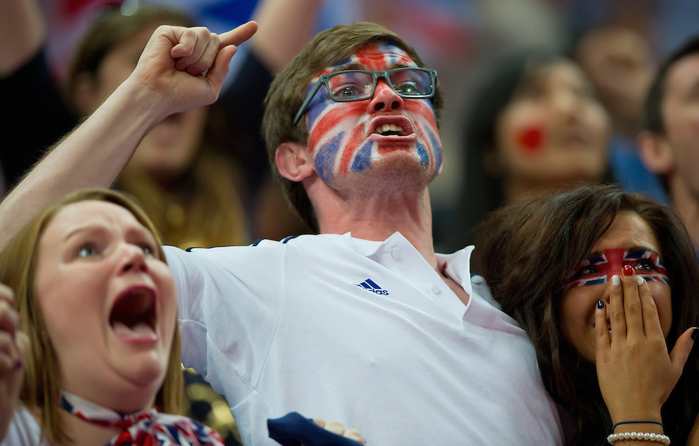 The family of Great Britain gymnast Kristian Thomas reacted at the end of Thomas's floor exercise routine in the men's team gymnastics final at North Greenwich Arena during the 2012 Summer Olympic Games in London, England, Monday, July 30, 2012. Great Britain was originally scored as the silver medalist but an inquiry review by judges moved Great Britain into third place. (David Eulitt/Kansas City Star/MCT)