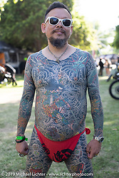 A Japanese visitor shows off his tattoos at the Born Free chopper show. Silverado, CA. USA. Saturday June 23, 2018. Photography ©2018 Michael Lichter.