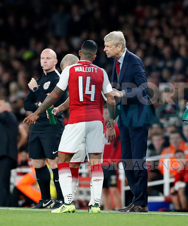 Arsenal's Theo Walcott talks to Arsene Wenger during the Carabao Cup Third Round match at the Emirates Stadium, London. Picture date 20th September 2017. Picture credit should read: David Klein/Sportimage