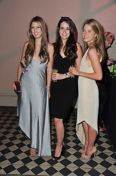 Left to right, STEPHANIE CAVALCANTI, ALEXIA KYRIAZI and FEDERICA BROZZETTI at a fashion show by Catherine Walker & Co in support of The Haven held at One Mayfair, North Audley Street, London on 18th May 2011.