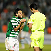 Referee's Abdullah YILMAZ show the yellow card to Bursaspor's Volkan SEN (R) during their Turkish soccer super league match Bursaspor between Kayserispor at Ataturk Stadium in Bursa Turkey on Saturday, 01 May 2010. Photo by TURKPIX
