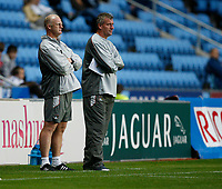 Photo: Steve Bond.<br />Coventry City v Notts County. The Carling Cup. 14/08/2007. Iain Dowie (L) & Tim Flowers (R) watch from the touchline