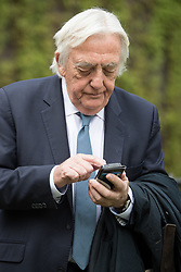 © Licensed to London News Pictures . 20/04/2017 . London , UK . BOB MARSHALL-ANDREWS using his mobile phone outside Parliament today (20th April 2017) . Bob Marshall Andrews has defected from the Labour Party to the Liberal Democrats . Photo credit: Joel Goodman/LNP