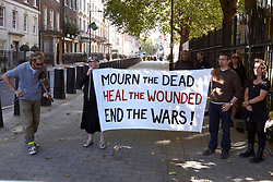 © Licensed to London News Pictures.  11/09/2011. LONDON, UK. Anti-war protesters outside the US Embassy in Grosvenor Square, London, on the 10 year anniversary of the September 11 attacks in New York. Photo credit :  Cliff Hide/LNP