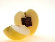 conceptual image on high tech agriculture. A cut apple with an INTEL microchip embedded inside