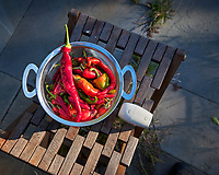 Hot Peppers grown on my Patio. Image taken with a Leica CL camera and 23 mm f/2 lens (ISO 100, 23 mm, f/3.5, 1/250 sec).