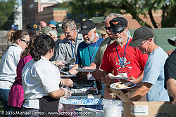 Cannonballers in line for a great hosted dinner in historic downtown Dodge City, KS during the Motorcycle Cannonball Race of the Century. Stage-8 from Wichita, KS to Dodge City, KS. USA. Saturday September 17, 2016. Photography ©2016 Michael Lichter.