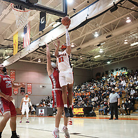 Gallup Bengal Jeffery Yazzie (21) drives to the basket against the Bernalillo Spartans during their New Mexico Class 4A boys basketball quarterfinal game at Gallup High School in Gallup Tuesday. The Bengals defeated the Spartans 70-67 to advance to the semifinals.