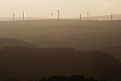 A wind farm in the distance. View from the slope of the Dumyat, a hill at the western extremity of the Ochil Hills, in central Scotland..Pic © Michael Schofield...