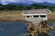 Central America, Honduras, between Tegucigalpa and Choluteca. Devastation in the aftermath of Hurricane Mitch. High winds and flooding. Soil erosion caused by deforestation. Bridge and motorway swept away. Reconstruction of infrastructure destroyed.