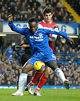 Photo: Ed Godden.<br /> Chelsea v Arsenal. The Barclays Premiership. 10/12/2006.<br /> Chelsea's Michael Essien is approached from behind by Francesc Fabregas.