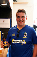AFC Wimbledon fan trying the new beer during the Pre-Season Friendly match between AFC Wimbledon and Burton Albion at the Cherry Red Records Stadium, Kingston, England on 21 July 2017. Photo by Matthew Redman.
