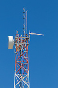 microwave and mobile radio antennas on red and white lattice tower in Jerilderie, New South Wales, Australia <br /> <br /> Editions:- Open Edition Print / Stock Image