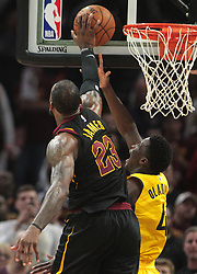 April 25, 2018 - Cleveland, OH, USA - The Cleveland Cavaliers' LeBron James (23) blocks a shot by the Indiana Pacers' Victor Oladipo in the closing seconds of Game 5 on Wednesday, April 25, 2018, at Quicken Loans Arena in Cleveland. The Cleveland Cavaliers won, 98-95, for a 3-2 lead in the first-round NBA playoff series. (Credit Image: © Leah Klafczynski/TNS via ZUMA Wire)