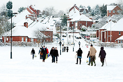 Ecclesfield park Sheffield, people choose to walk rather than take their cars through the most widespread Snows to hit Britain for 20 years.1st December 2010.Images © Paul David Drabble