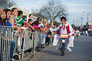 """Members of """"The World Famous Wheelie-ing Elvi"""" perform during the fifth-annual Oak Cliff Mardi Gras Parade on Sunday, February 10, 2013 in Dallas, Texas. (Cooper Neill/The Dallas Morning News)"""