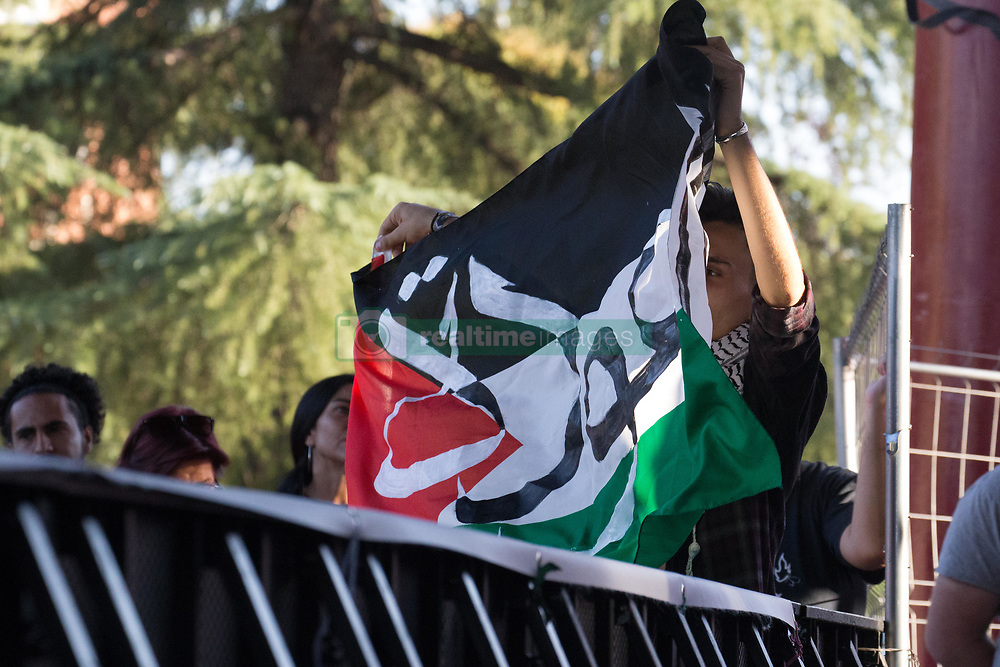 September 29, 2018 - Madrid, Spain - A man seen raising a Palestinian flag during the tour..Ahed Tamimi on his European tour during the Spanish Communist festivities Party, He is an activist who was sentenced to eight months in prison for assaulting an Israeli soldier at home a few hours after his 15-year-old cousin was shot with a rubber bullet on the head. (Credit Image: © Lito Lizana/SOPA Images via ZUMA Wire)