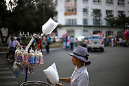 A street vendor sells popcorn on her cart during Tet festivities in Ho Chi Minh City, Vietnam, Southeast Asia, February 2011.