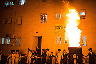 Orthodox jews dancing next to the bonefire during the Lag BaOmer celebrations in the orthodox distric of Mea Shearim