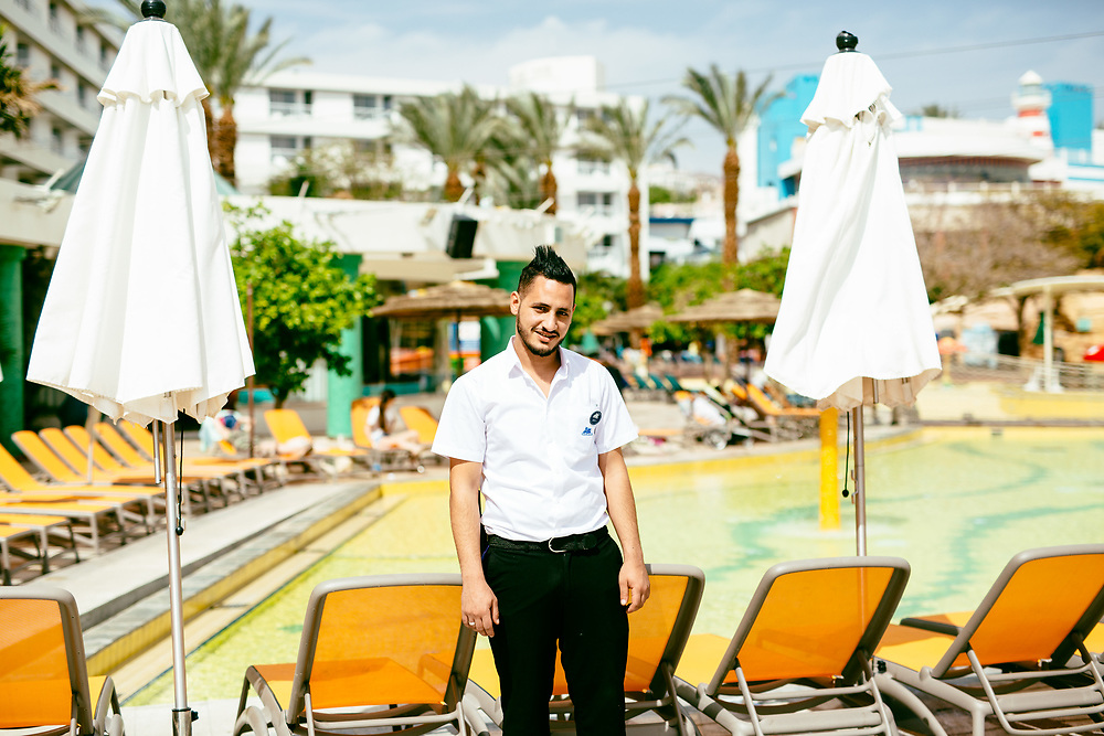 Yazan Abu Addi, 23, a Jordanian employee from Aqaba, poses for a portrait at Club Hotel Eilat, a suites hotel in Eilat, southern Israel, on March 15, 2018.
