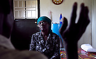Rose Lalaa Oyest the lead counselor and testor in Nimule speaks with a SLPA member.