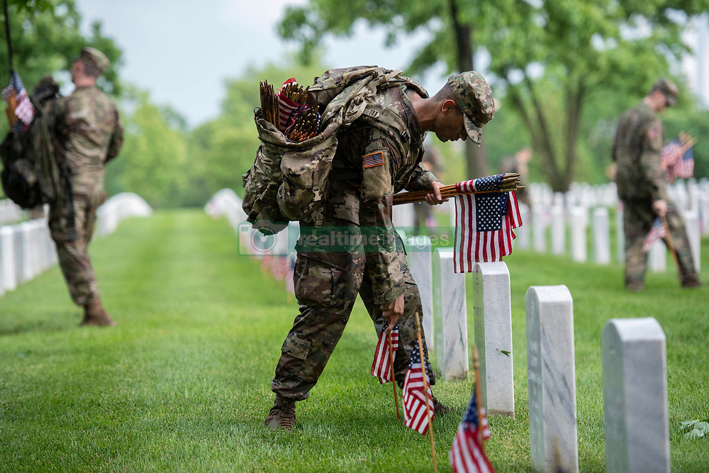 May 23, 2019 - Arlington, Virginia, U.S. - Soldiers from the 3d U.S. Infantry Regiment (The Old Guard) place U.S. flags at headstones as part of Flags-In at Arlington National Cemetery, Arlington, Virginia, May 23, 2019. For more than 55 years, soldiers from the Old Guard have honored our nations fallen heroes by placing U.S. flags at gravesites for service members buried at both Arlington National Cemetery and the U.S. Soldiers' and Airmen  Home National Cemetery just prior to the Memorial Day weekend. Within four hours, over 1,000 soldiers place 245,000 flags in front of every headstone and Columbarium and niche wall column. (Credit Image: ? U.S. Army/ZUMA Wire/ZUMAPRESS.com)
