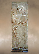 Stone relief sculptured panel of a man holding poppy seed pods. Facade N. Inv AO 19870 from Dur Sharrukin the palace of Assyrian king Sargon II at Khorsabad, 713-706 BC.  Louvre Museum Room 4 , Paris .<br /> <br /> If you prefer to buy from our ALAMY PHOTO LIBRARY  Collection visit : https://www.alamy.com/portfolio/paul-williams-funkystock/ancient-assyria-antiquities.html  Refine search by adding background colour, place, subject, museum etc into the LOWER SEARCH WITHIN GALLERY box to <br /> <br /> Visit our ANCIENT WORLD PHOTO COLLECTIONS for more photos to download or buy as wall art prints https://funkystock.photoshelter.com/gallery-collection/Ancient-World-Art-Antiquities-Historic-Sites-Pictures-Images-of/C00006u26yqSkDOM