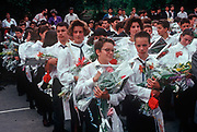 1990s teenage students receive flowers from their parents on the last day of the school term, on 13th June 1990, in Budapest, Hungary.