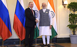 October 15, 2016 - Goa, India - Russian President Vladimir Putin is greeted by Indian Prime Minister Narendra Modi before the start of a bilateral meeting on the sidelines of the BRICS Summit at the Taj Exotica hotel October 15, 2016 in Goa, India. (Credit Image: © Dmitry Azarov/Planet Pix via ZUMA Wire)