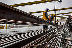 May 5, 2018 - Workers lay tracks at the construction site of Wuhan-Shiyan high-speed railway in Zaoyang, central China's Hubei Province, May 5, 2018. The 399-km-long line will operate in 2019. (Credit Image: © Du Huaju/Xinhua via ZUMA Wire)