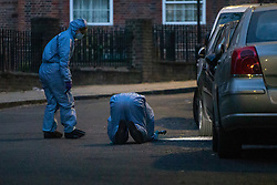 © Licensed to London News Pictures. 03/08/2020. London, UK. Police officers, forensics examiners search the scene of a shooting at Tilson Gardens, Brixton, that happened around 6.38pm on August 3rd, where a man was taken to hospital with a gunshot injury. Photo credit: Paul Davey/LNP