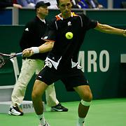 NLD/Rotterdam/20100209 - ABN - Amro Tennistoernooi 2010,  Novak Djokovic (black/red shirt) - Sergiy Stakhovsky (black/orange/white shirt)