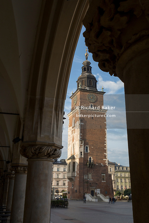 Renaissance arches of the Cloth Hall and the City Hall Tower on Rynek Glowny market square, on 23rd September 2019, in Krakow, Malopolska, Poland.